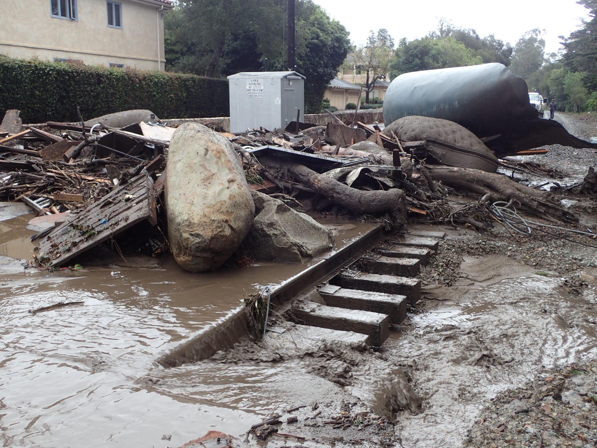 The main line of the Union Pacific Railroad through Montecito is blocked with mudflow and debris due to heavy rains. (Photo: Mike Eliason / Santa Barbara County Fire)