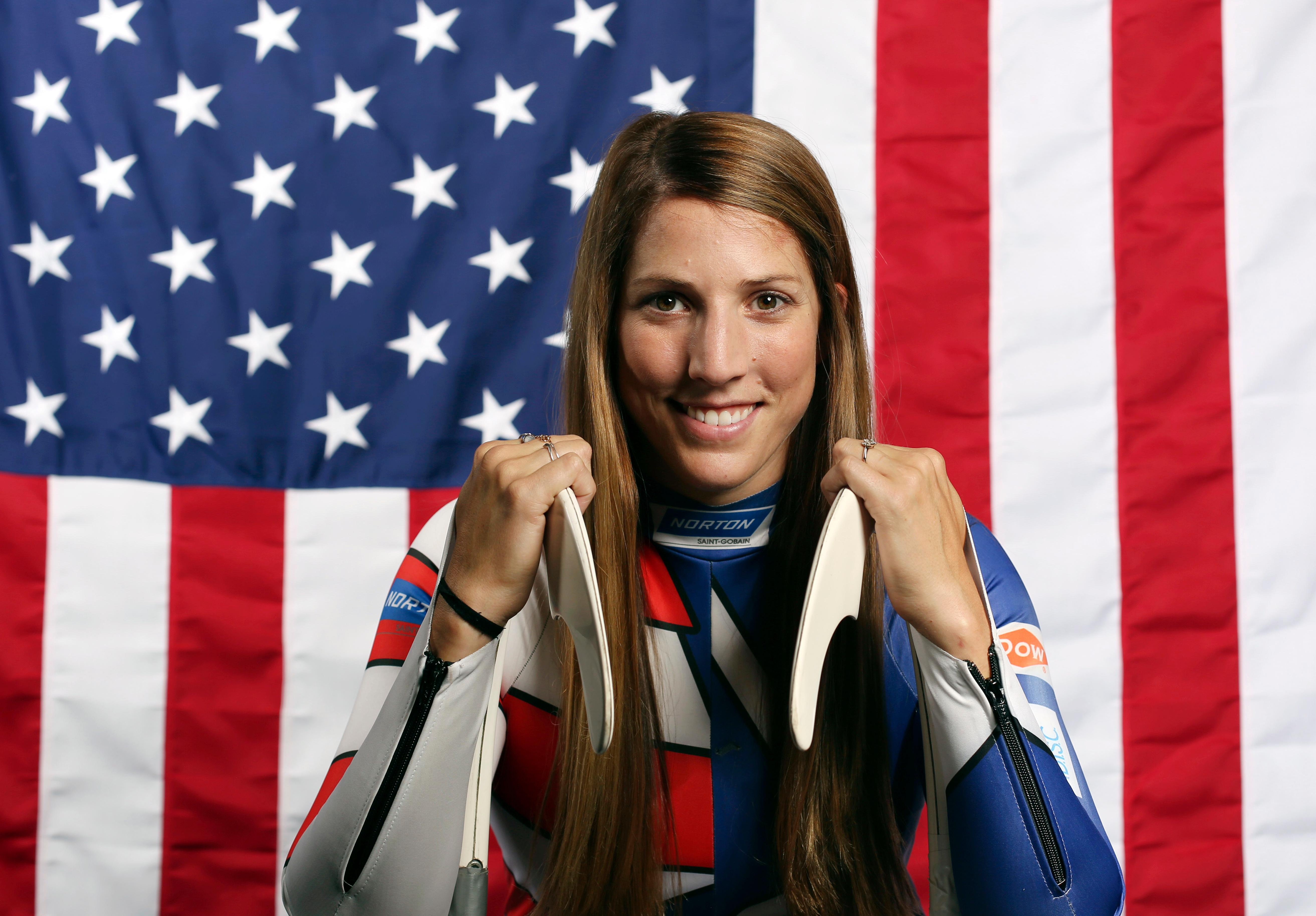 FILE - In this Sept. 25, 2017, file photo, United States Olympic Winter Games luge hopeful Erin Hamlin poses for a portrait at the 2017 Team USA Media Summit in Park City, Utah. Hamlin will carry the U.S. flag into Friday night's opening ceremony at the Pyeongchang Olympics on Feb. 9, 2018. The four-time Olympic luger was chosen by fellow Team USA Olympians for the honor. Hamlin is retiring at the end of these Olympics, after nearly two decades of racing competitively. (AP Photo/Rick Bowmer, File)