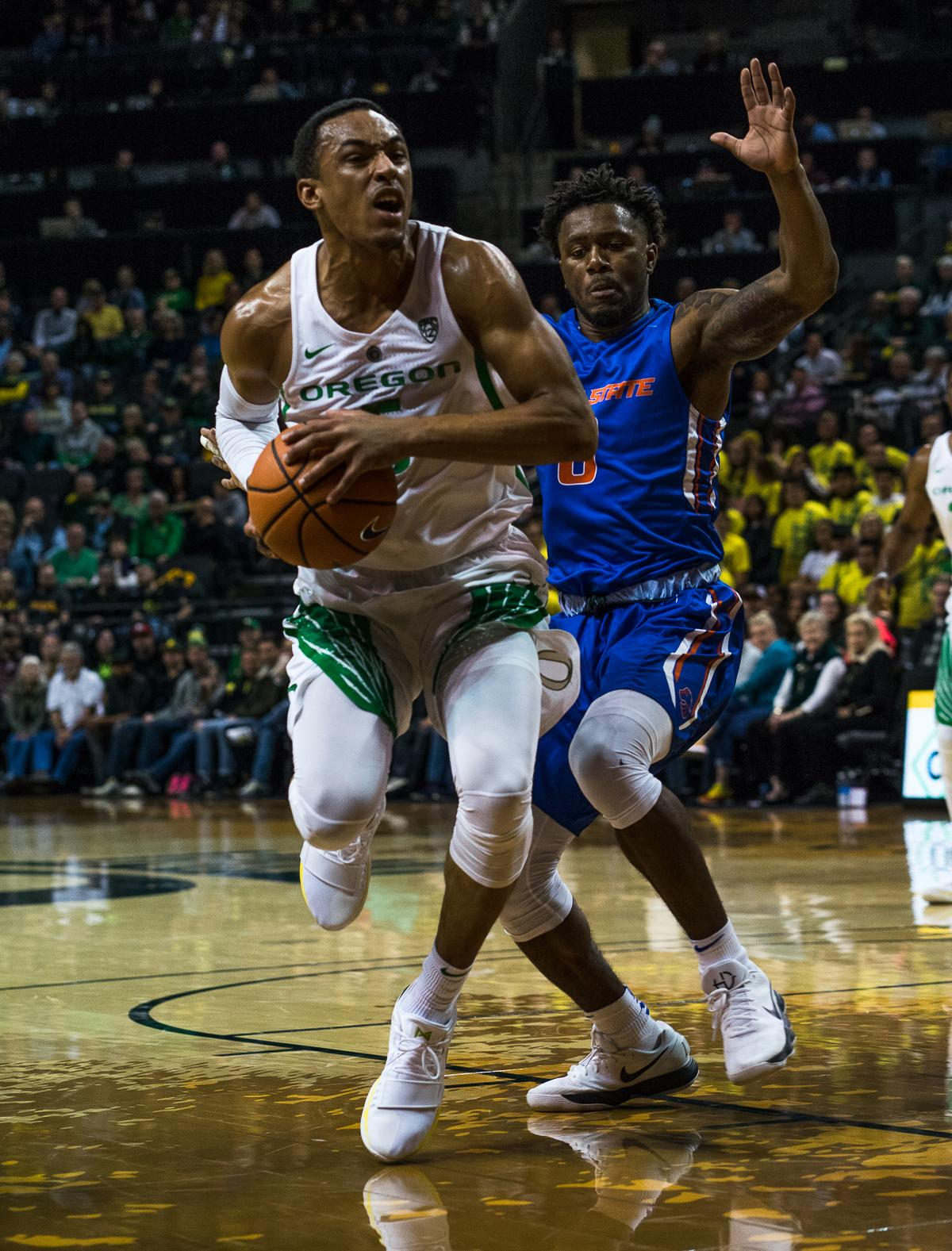University of Oregon Duck Elijah Brown (#5) drives past Boise State Bronco Marcus Dickinson (#0). The Boise State Broncos defeated the University of Oregon Ducks 73 – 70 at Matthew Knight Arena in Eugene, Ore., on December 1, 2017. Photo by Kit MacAvoy, Oregon News Lab