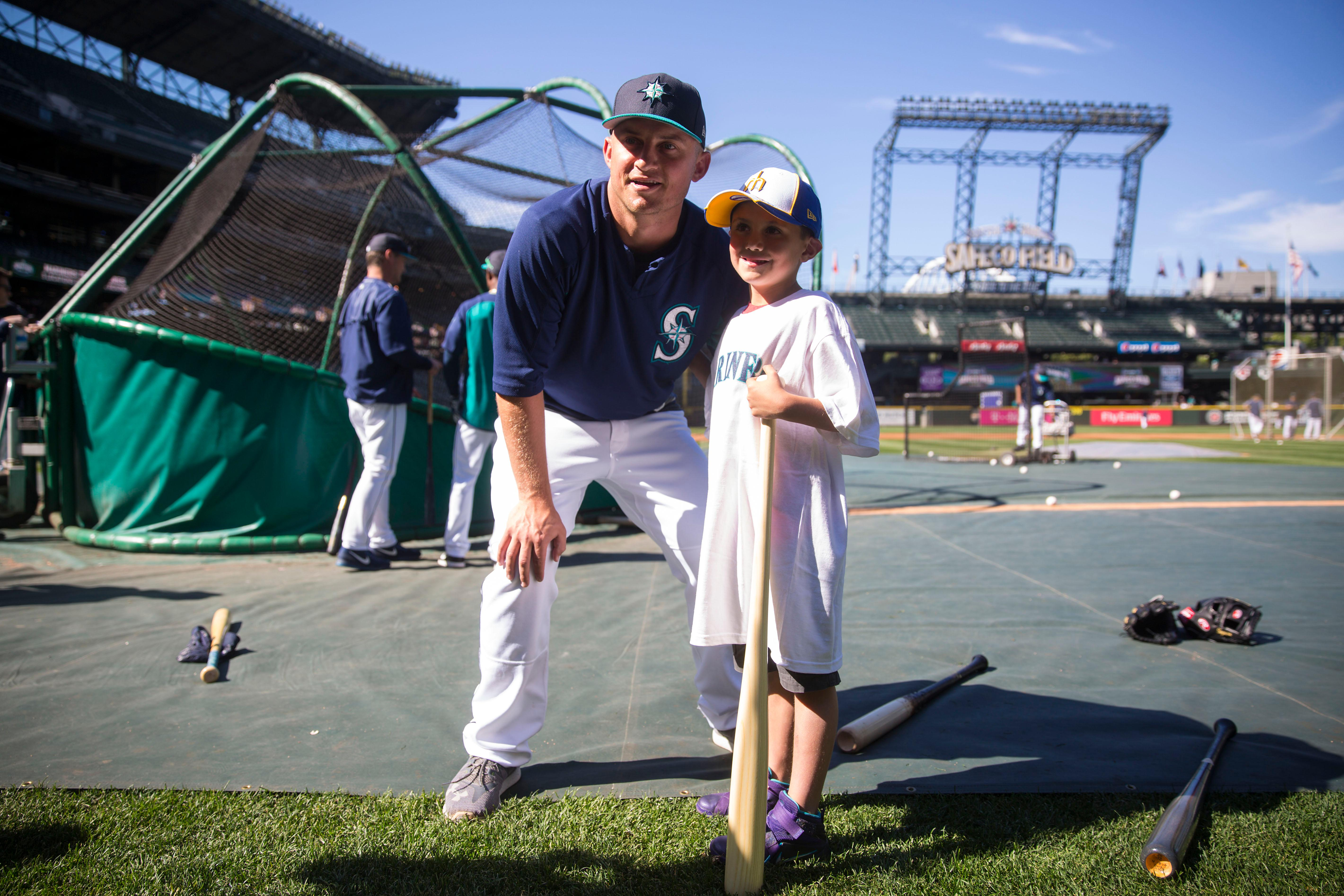 "Seven-year-old kidney cancer survivor Mason Nettleton poses with Seattle Mariner Kyle Seager as Nettleton served Seattle as a ""Superhero for a Day"" on Tuesday, June 27, 2017. (Sy Bean/ Seattle Refined)"