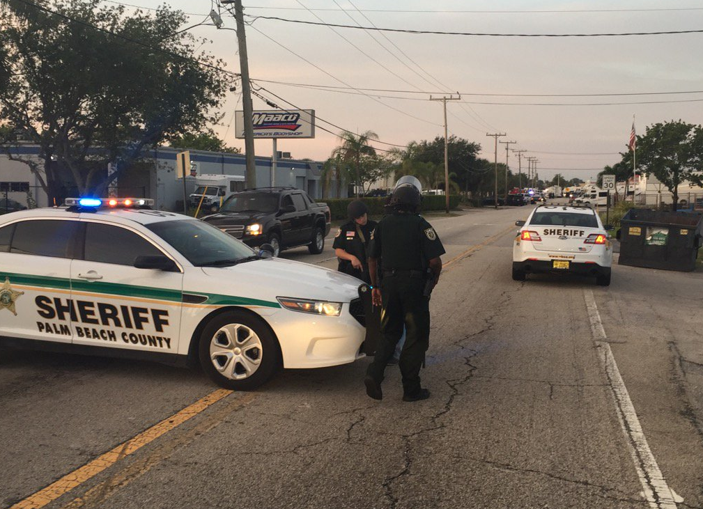 The Palm Beach County Sheriff's Office and West Palm Beach  police shutdown roads in West Palm Beach following a shooting. (WPEC)