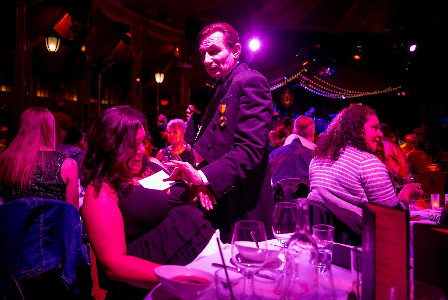 "Ukrainian-born illusionist Voronin, sought-after stars of the European cabaret circuit, plays tricks on guests during Teatro ZinZanni's show, ""Love, Chaos, and Dinner."" The dinner show is a three-hour evening of international cirque, comedy, and cabaret, served up with a multi-course meal designed by James Beard award-winning chef Jason Wilson. (Sy Bean / Seattle Refined)"