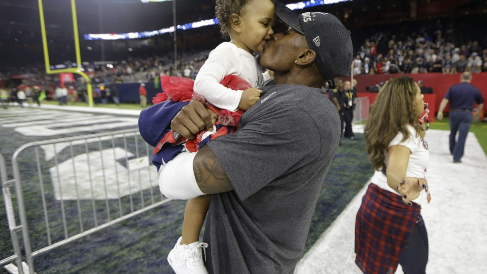 The New England Patriots' Jonathan Jones celebrates with his daughter Skyler after defeating the Atlanta Falcons in Super Bowl 51 in Houston on Sunday, Feb. 5, 2017. The Patriots defeated the Falcons 34-28. THE ASSOCIATED PRESS