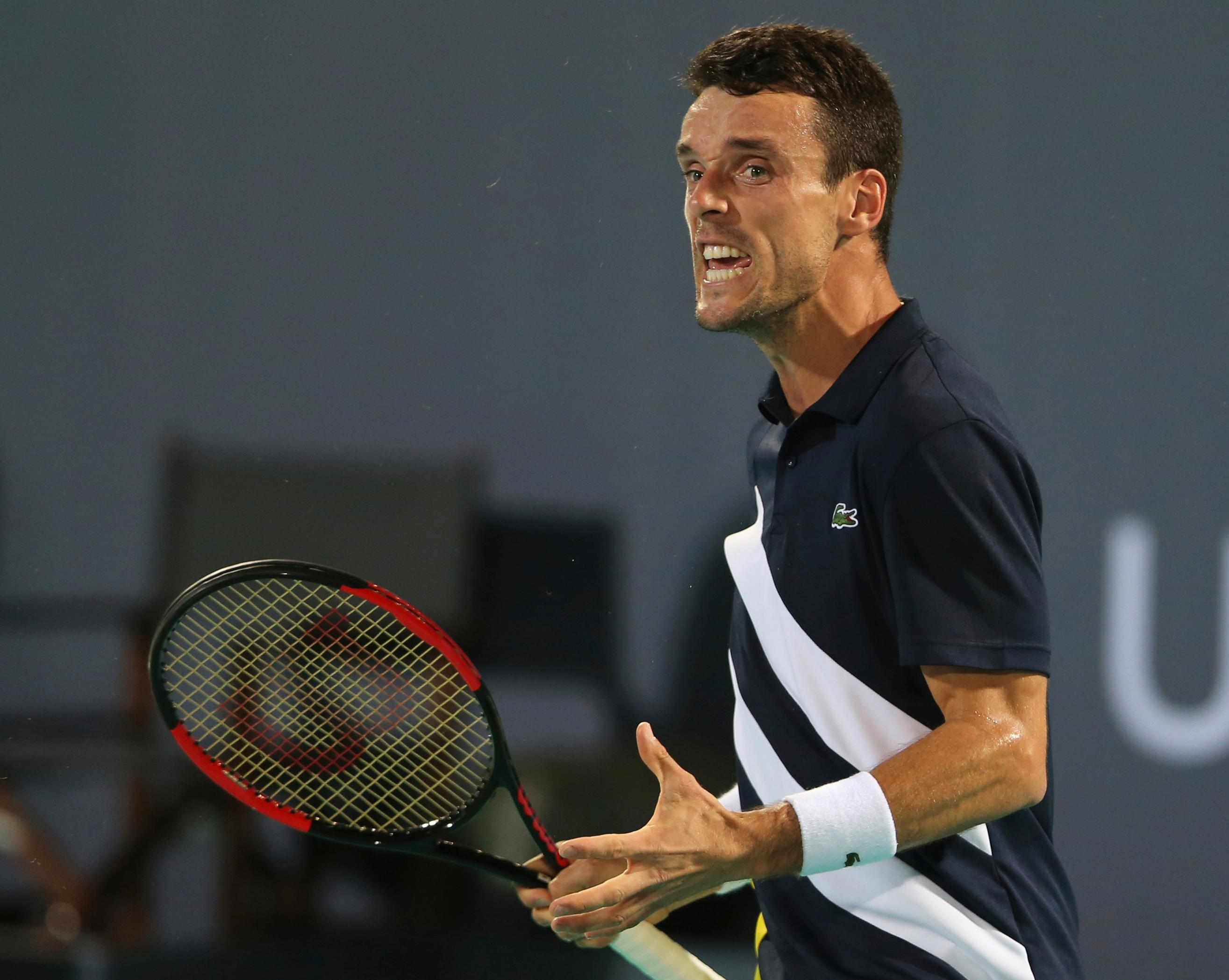 Spain's Roberto Bautista Agut reacts at the final match against South Africa's Kevin Anderson during the Mubadala World Tennis Championship in Abu Dhabi, United Arab Emirates, Saturday, Dec. 30, 2017. (AP Photo/Kamran Jebreili)