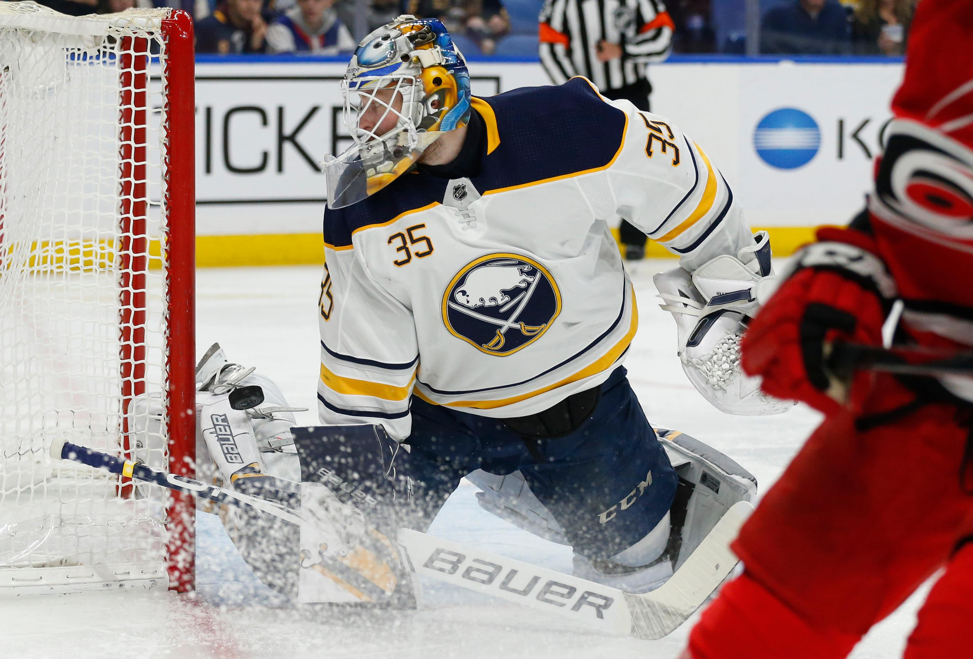Buffalo Sabres goalie Linus Ullmark (35) makes a pad save during the second period of an NHL hockey game against the Carolina Hurricanes on Thursday, Feb. 7, 2019, in Buffalo N.Y. (AP Photo/Jeffrey T. Barnes)