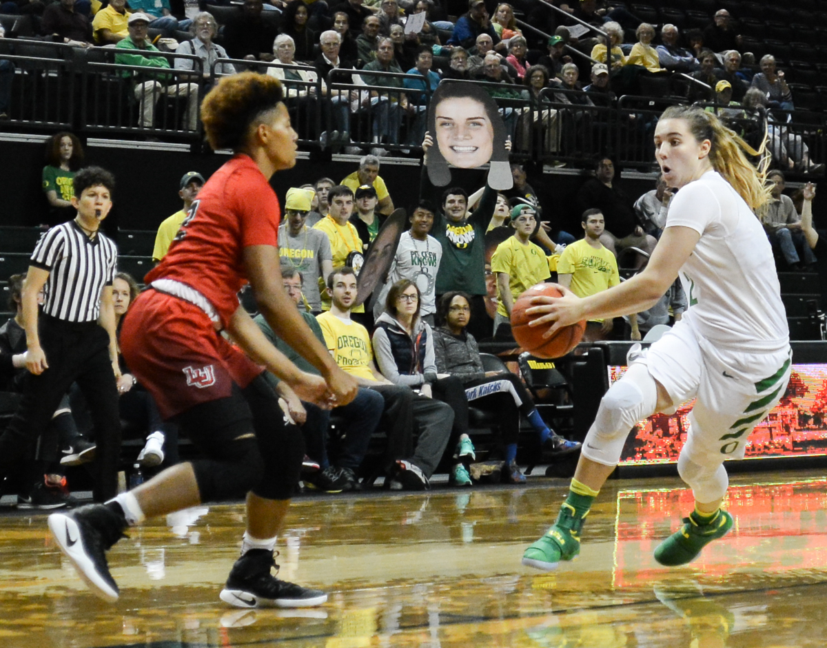 Ducks Morgan Yaeger (#2) dances around Cardinals Khali Pippins-Tryon (#32) for a lay up. The Oregon Ducks women's basketball team won their season opener against the Lamar Cardinals 84-67. Photo by Jacob Smith, Oregon News Lab