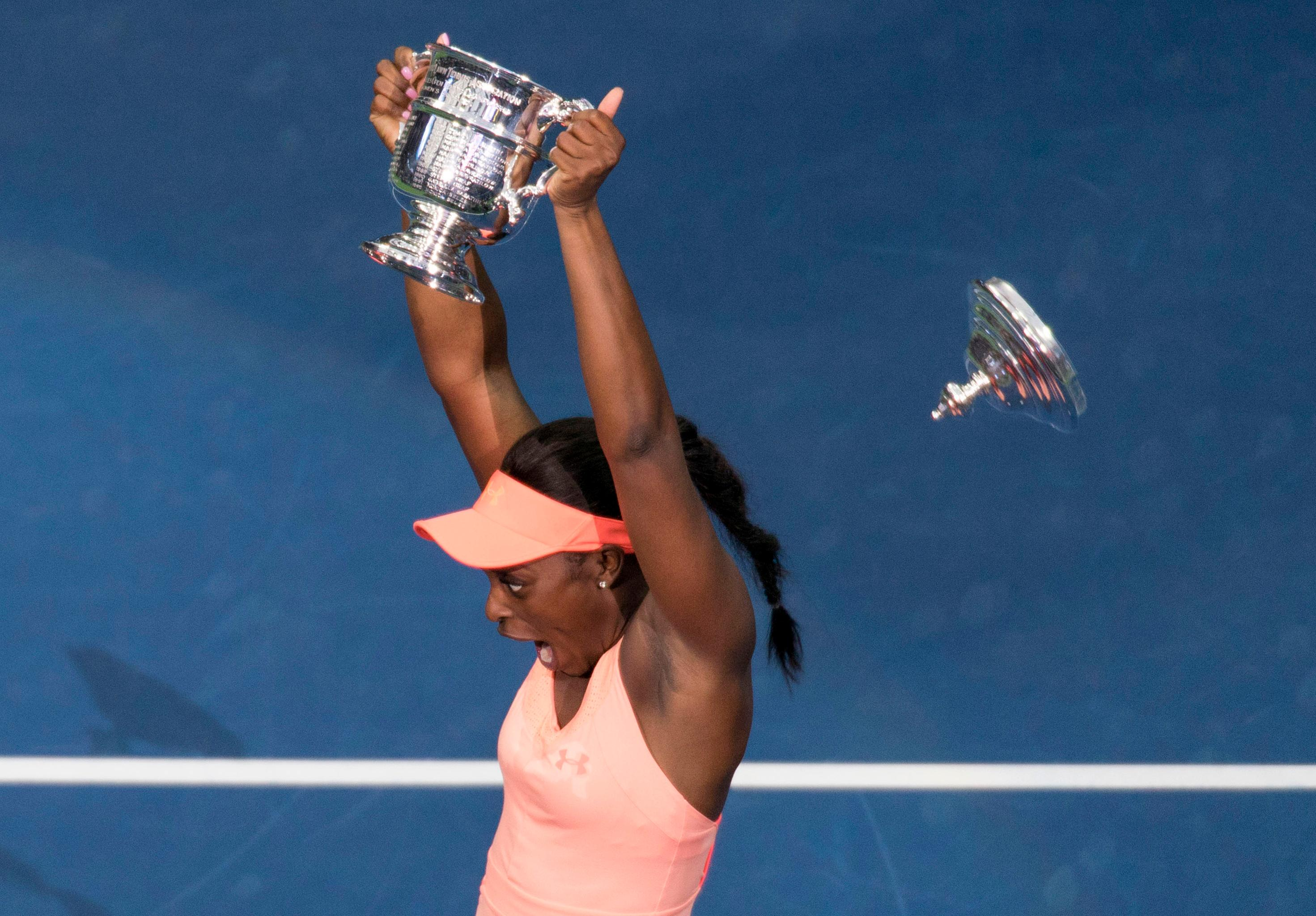 Sloane Stephens, of the United States, reacts as the lid to the championship trophy falls off during a photo app after the women's singles final of the U.S. Open tennis tournament, Saturday, Sept. 9, 2017, in New York. Stephens beat Madison Keys, of the United States to win the championship. (AP Photo/Nick Didlick)