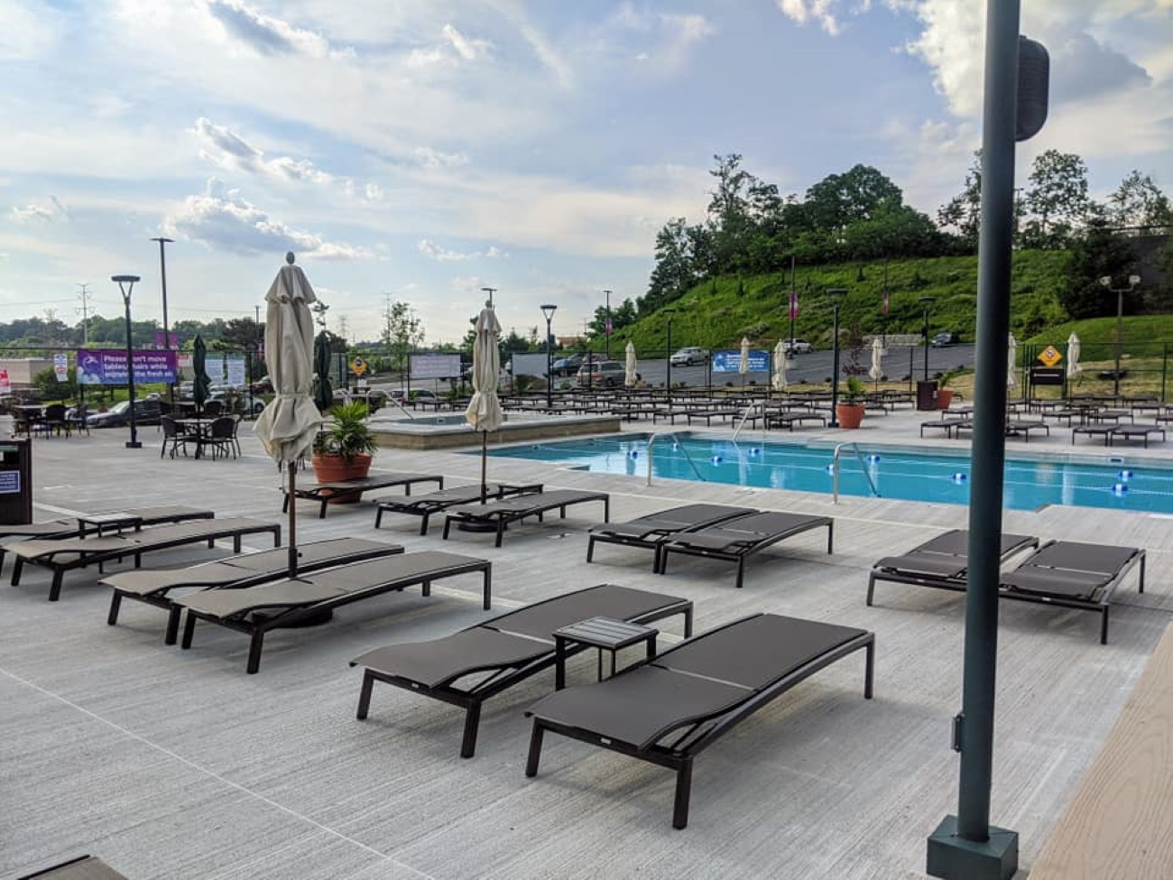 <p>The pool features a poolside bar and café, lounge pool with steps, and an adult-only hot and cool tub. The pool deck can accommodate up to 250 lounge chairs and table and bar seating. / Image courtesy of Cincinnati Sports Club // Published: 6.27.20</p>