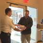 Employees with Harris Corp. drop off pies with first responders for Pi Day