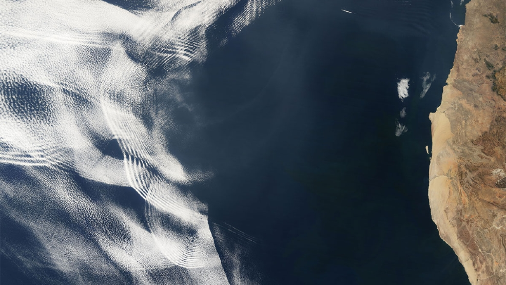 Gravity waves make for surreal cloud scene off African coast