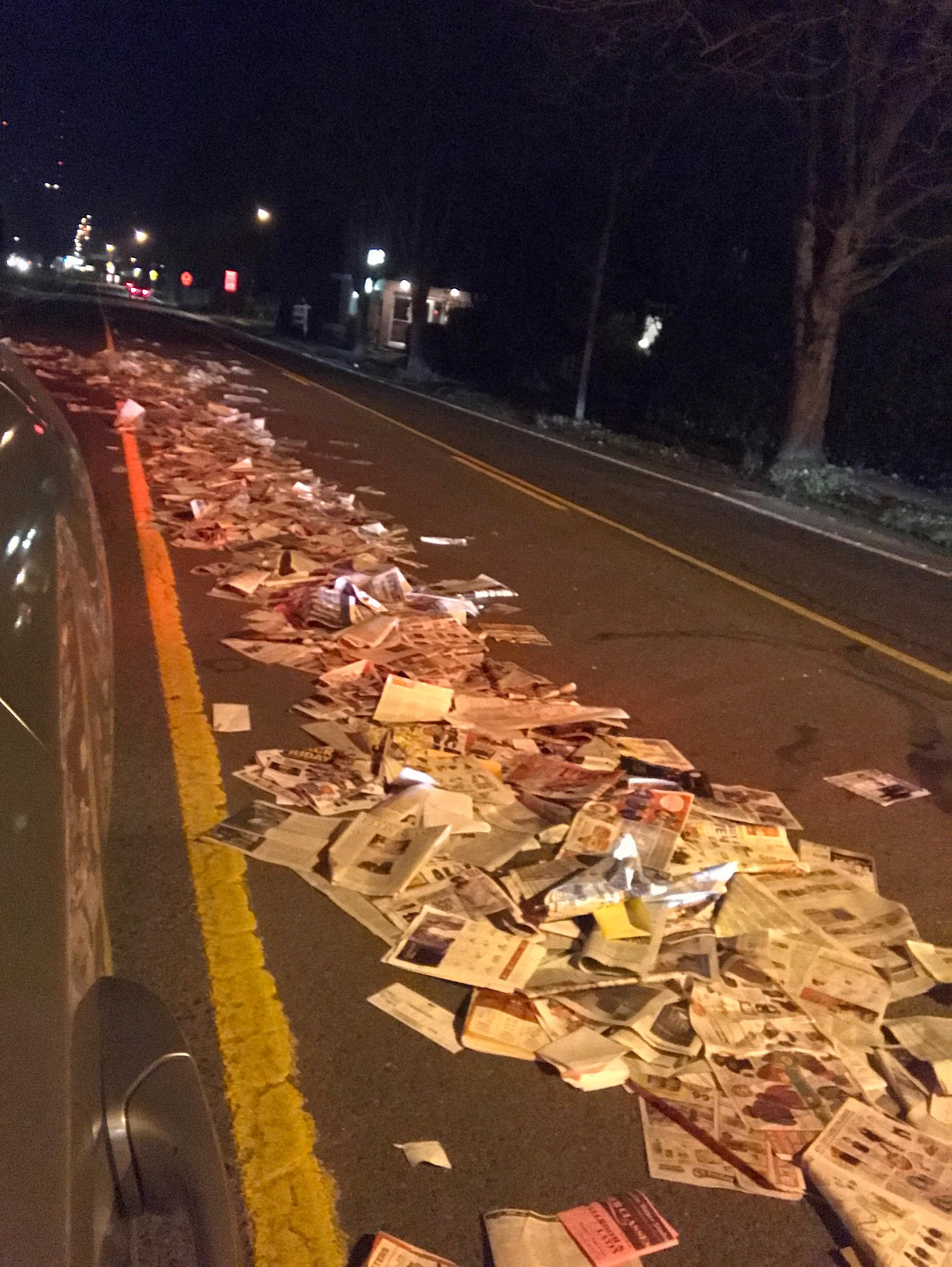 A reporter found newspapers spread across Chambers Street at 13th Avenue on Monday evening, December 11, 2017. (Clara Benitez)<p></p>