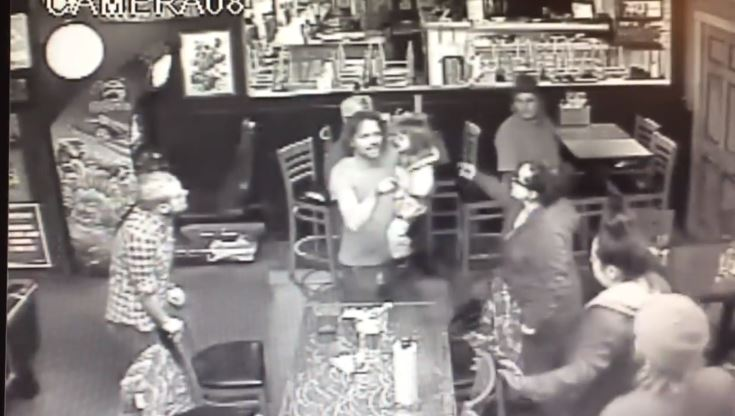 WARNING: VIDEO CONTAINS VIOLENCE. Deputies are looking for one of two men who attacked a man in a Colorado bar. The attackers punched the victim in the face while he held his daughter in his arms. (Jefferson County Sheriff's Office)