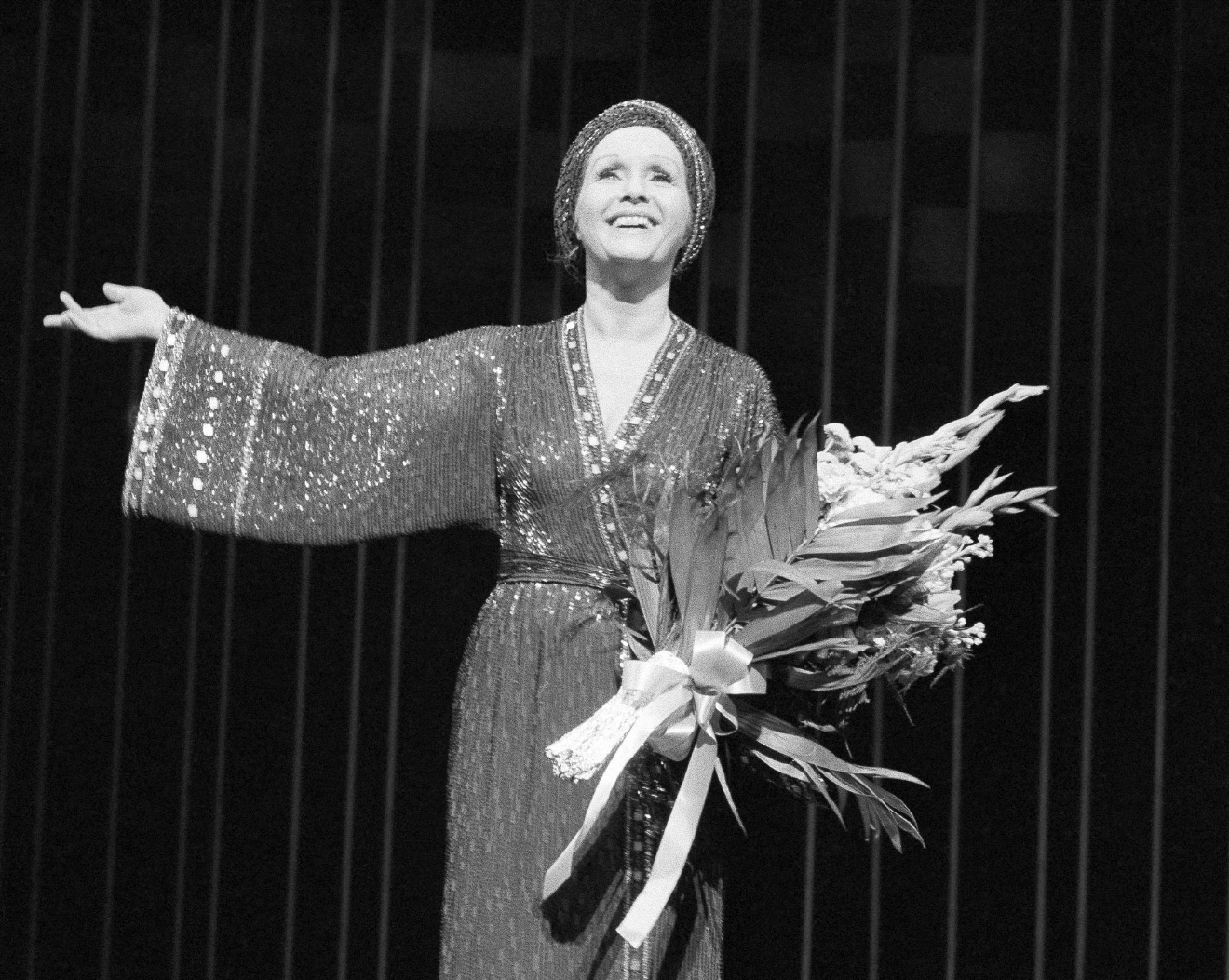 "FILE- In this March 8, 1983, file photo, actress Debbie Reynolds returns for a curtain call after a performance of ""Woman of the Year"" at New York's palace theatre. Reynolds, star of the 1952 classic ""Singin' in the Rain"" died Wednesday, Dec. 28, 2016, according to her son Todd Fisher. She was 84. (AP Photo/Kaye, File)"