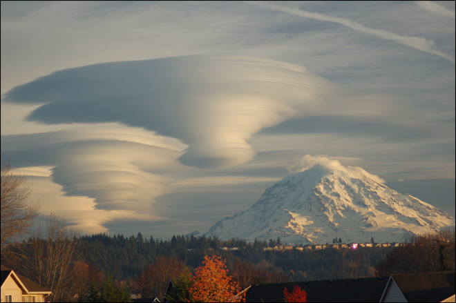Photo of lenticular clouds over Mt. Rainier on Dec. 5, 2008. (Photo courtesy: Tim Thompson)