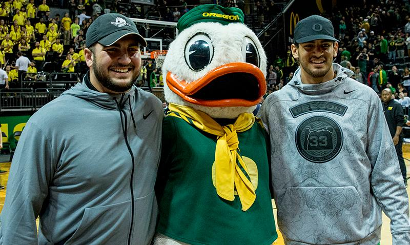 Former Oregon football players Marcus Mariota (right) and Hroniss Grasu (left) pose with the Oregon Duck following Oregon's win. Paced by 25 points from sophomore Dillon Brooks, Oregon defeated UCLA 86-72 in front of a crowd of 10,525 at Matthew Knight Arena on Saturday afternoon in Eugene, Oregon. With the win, the Ducks move to 16-4 on the season and 5-2 in PAC-12 play. Eric Cech, Oregon News Lab