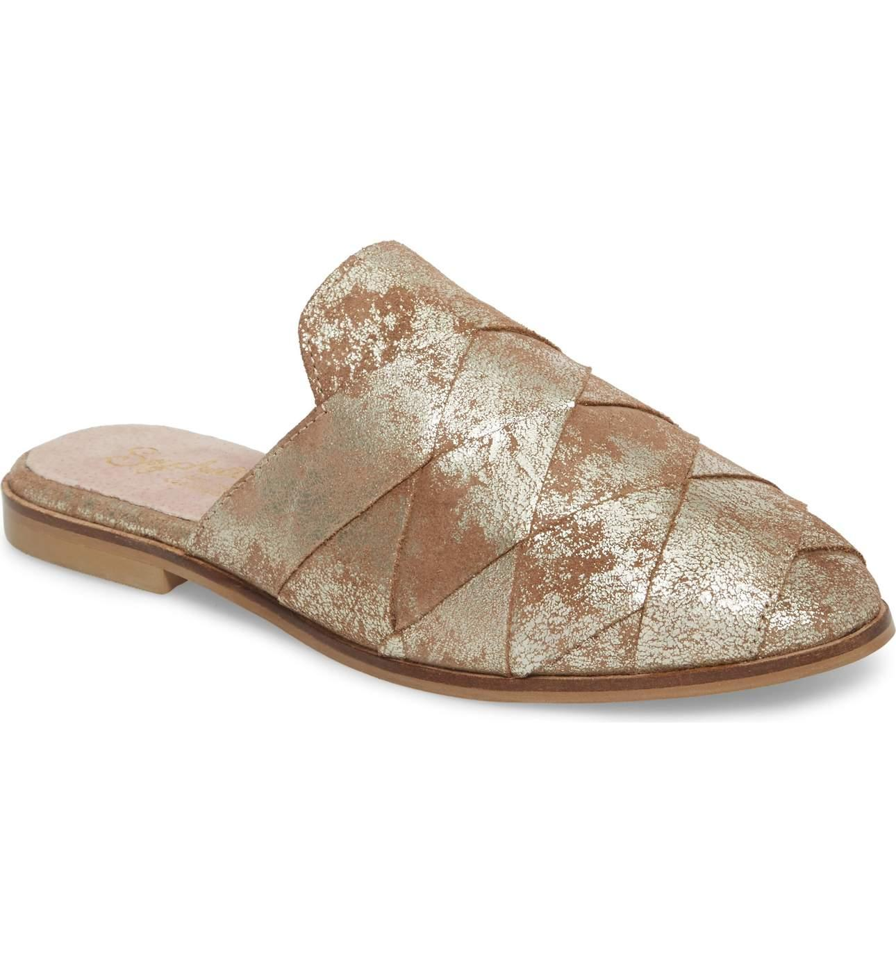 <p>Warning:{&nbsp;} You are going to see these flats everywhere this spring.{&nbsp;} I love these Mule/SEYCHELLES.{&nbsp;}Wide leather straps are woven together to create a sophisticated, wear-anywhere mule. The gold is to die for. $99.95 at Nordstrom. (Image: Nordstrom){&nbsp;}</p><p><br></p><p></p>