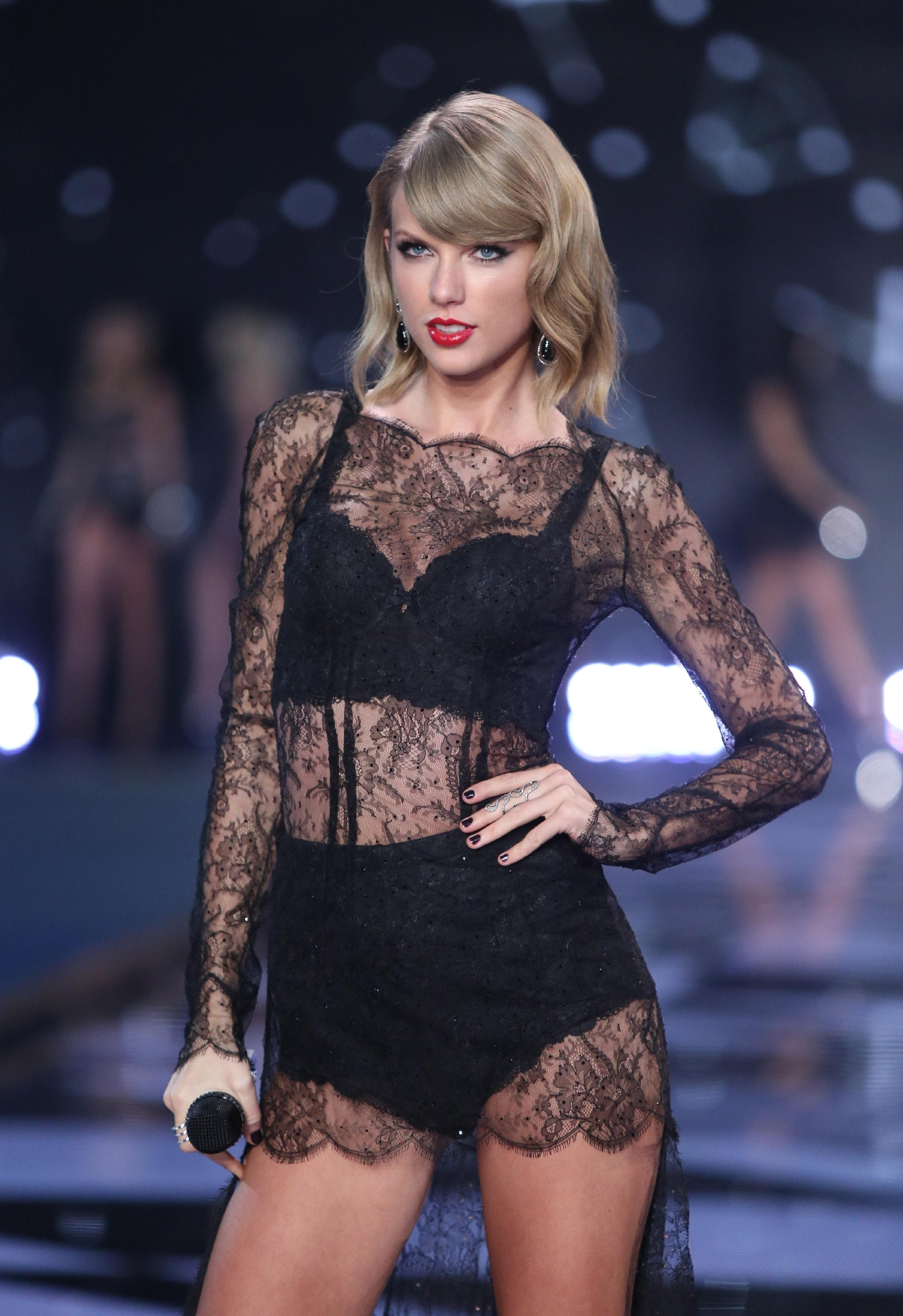 Taylor Swift performs at a Victoria's Secret fashion show in London on Dec. 2, 2014. (Photo credit: Joel Ryan/Invision/AP.)