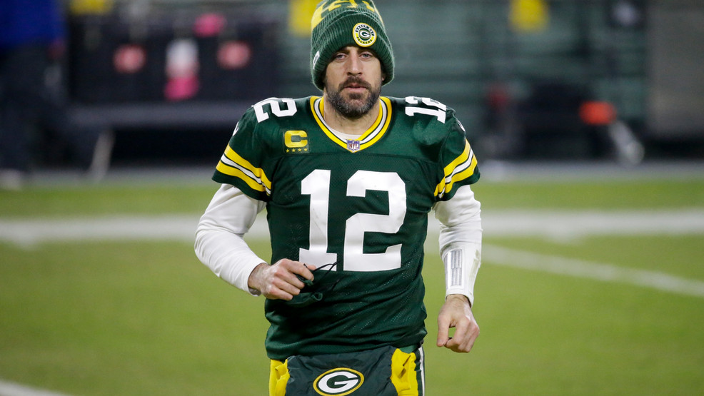Green Bay Packers' Aaron Rodgers runs off the field after a game against the Carolina Panthers Saturday, Dec. 19, 2020, in Green Bay. The Packers won 24-16.
