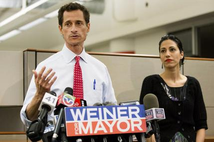 FILE - In this July 23, 2013 file photo, then-New York mayoral candidate Anthony Weiner speaks during a news conference alongside his wife Huma Abedin in New York. The FBI informed Congress on Friday, Oct. 28, 2016, it is investigating whether there is classified information in new emails that have emerged in its probe of Hillary Clinton's private server. A U.S. official told The Associated Press the newly discovered emails emerged through the FBI's separate sexting probe of former congressman Anthony Weiner, the estranged husband of close Clinton confidant Huma Abedin.  (AP Photo/John Minchillo, File)