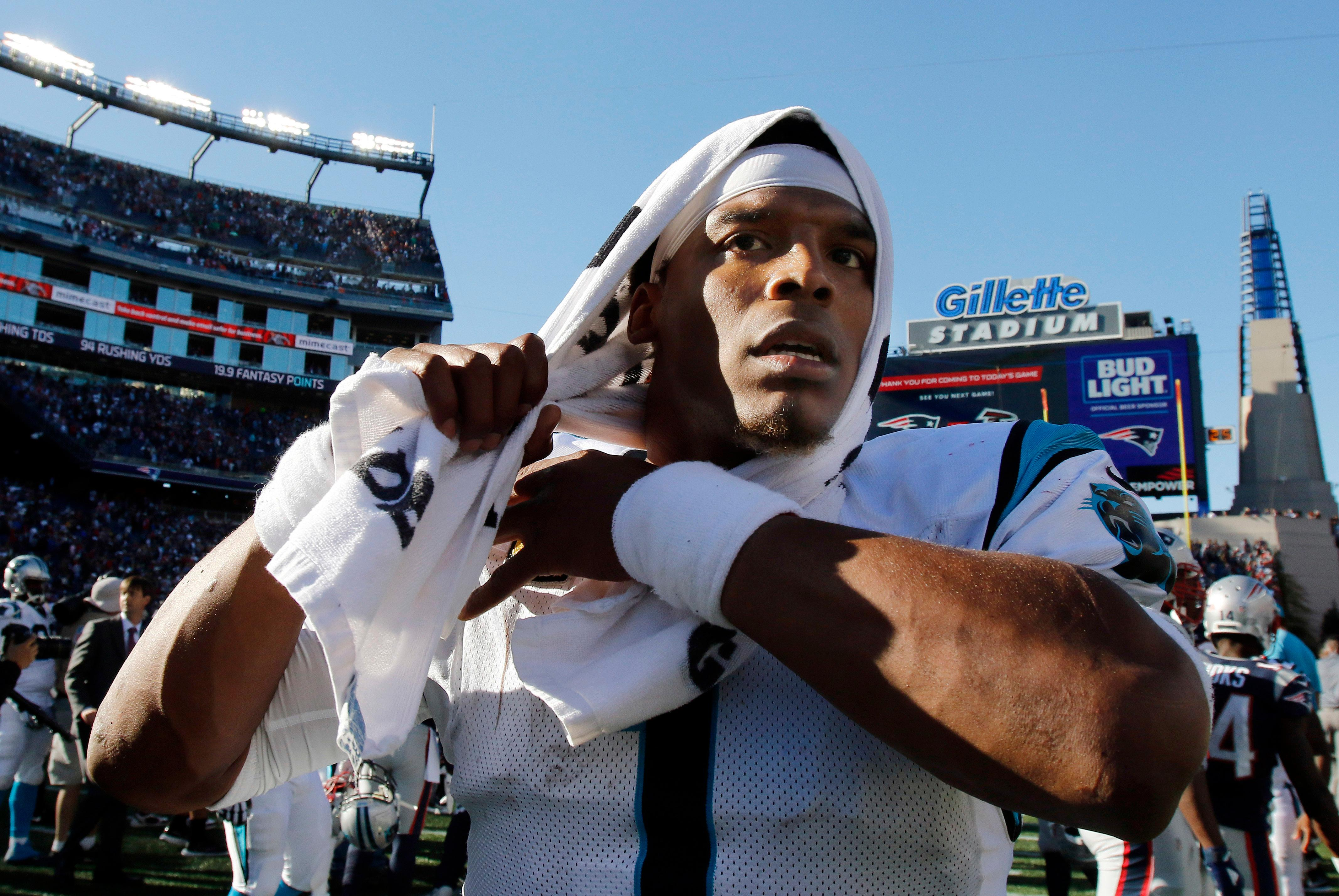 Carolina Panthers quarterback Cam Newton leaves the field after a 33-30 victory over the New England Patriots in an NFL football game, Sunday, Oct. 1, 2017, in Foxborough, Mass. (AP Photo/Bill Sikes)