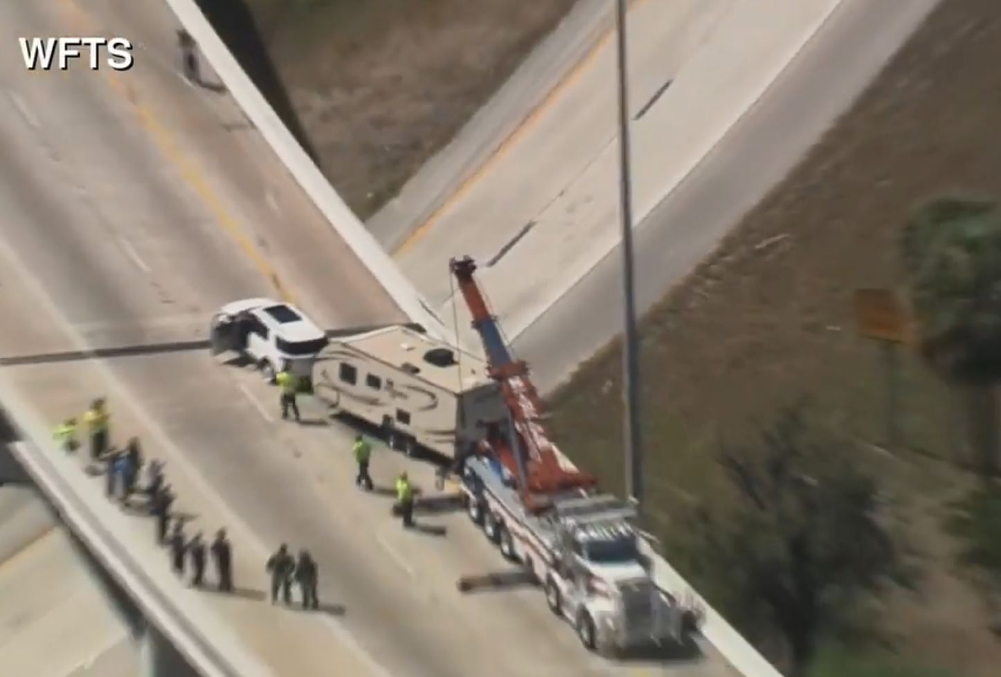 Camper dangles from Florida overpass. (WFTS via CNN Newsource)