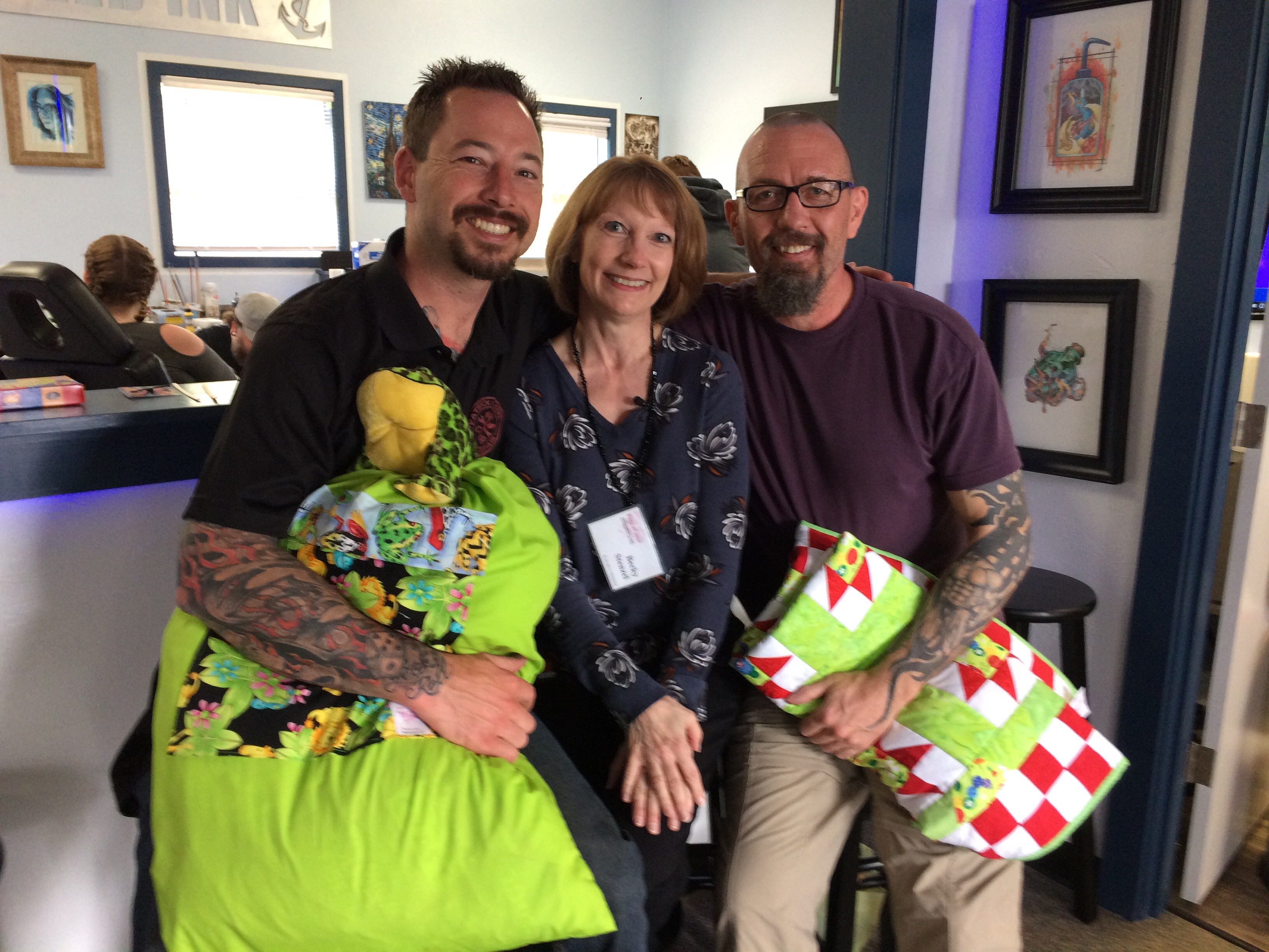 Event organizer Patrick Olsen (Left), Bags of Love Executive Director Becky Stenzel (Center), Anchored Ink Tattoos Co-owner, Joshua South (Right). (SBG Photo)