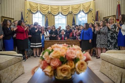 DAY 97 - In this April 26, 2017, file photo, President Donald Trump, center, speaks at a National Teacher of the Year event in the Oval Office at the White House in Washington. (AP Photo/Andrew Harnik, File)