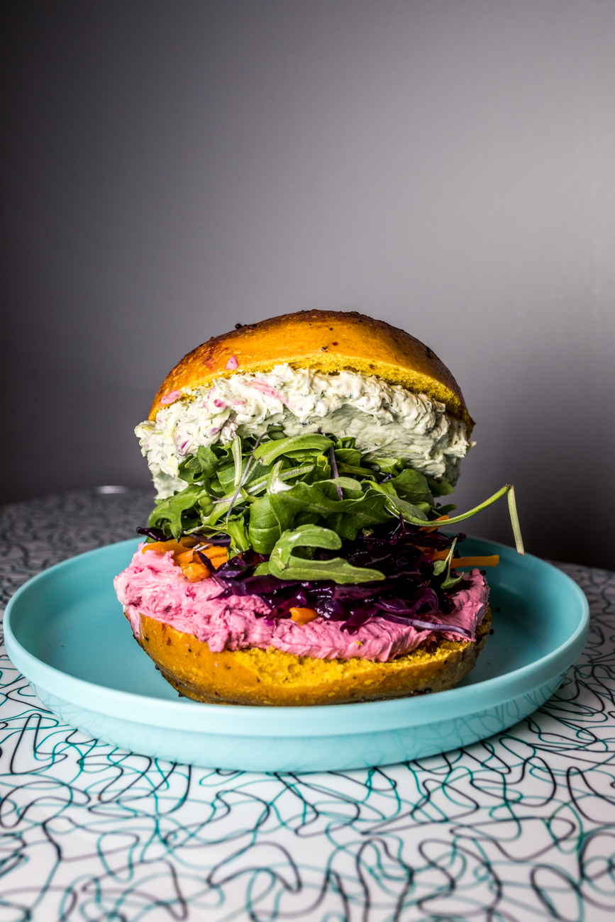 The Bad Judy: beet & veggie spread, mint chutney spread, spicy greens, pickled carrots, and kraut on a spicy turmeric beet bagel / Image: Catherine Viox // Published: 7.24.20