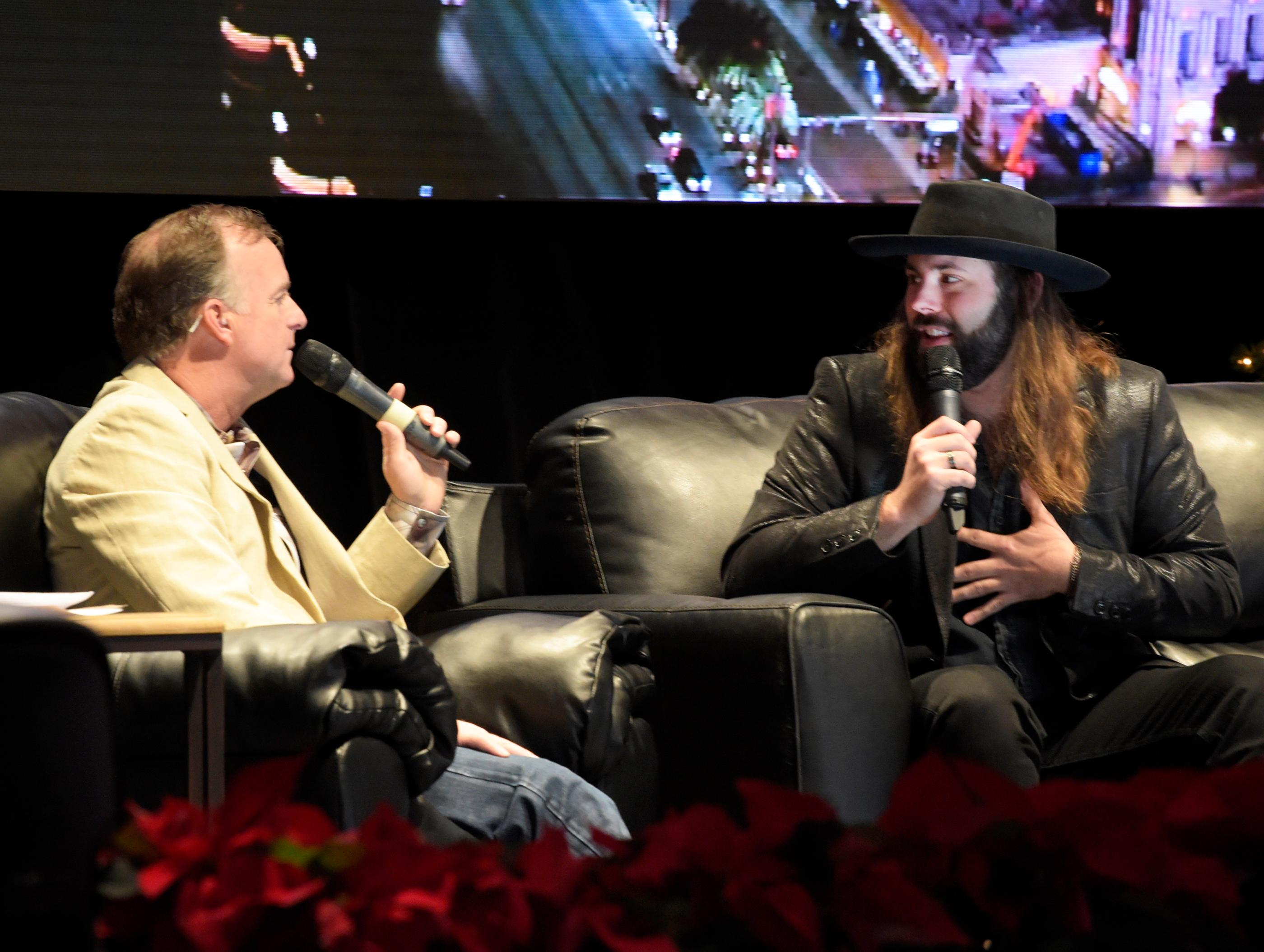 """Outside the Barrel"" with Flint Rasmussen, Entertainer and Rodeo Clown, interviewing Country singer/songwriter CJ Solar on the Rodeo Live Stage during Cowboy Christmas at the Las Vegas Convention Center . Sunday December 10, 2017. [Glenn Pinkerton/Las Vegas News Bureau]"