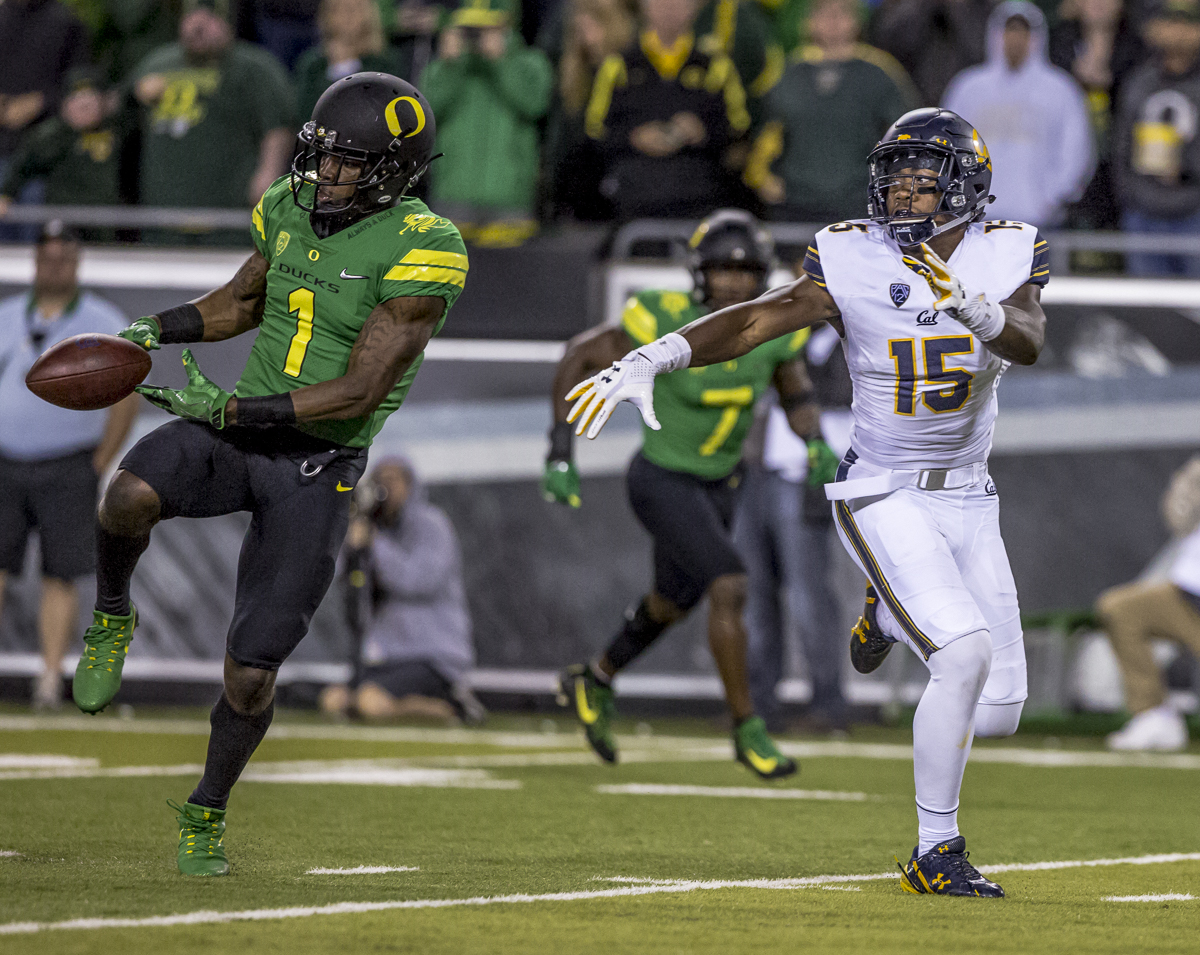 Oregon center back Arrion Springs (#1) attempts to intercept a pass intended for California wide receiver Jordan Veasy (#15). The Oregon Ducks defeated the California Golden Bears 45 to 24 during an evening game on Saturday September 30, 2017. Photo by Ben Lonergan, Oregon News Lab