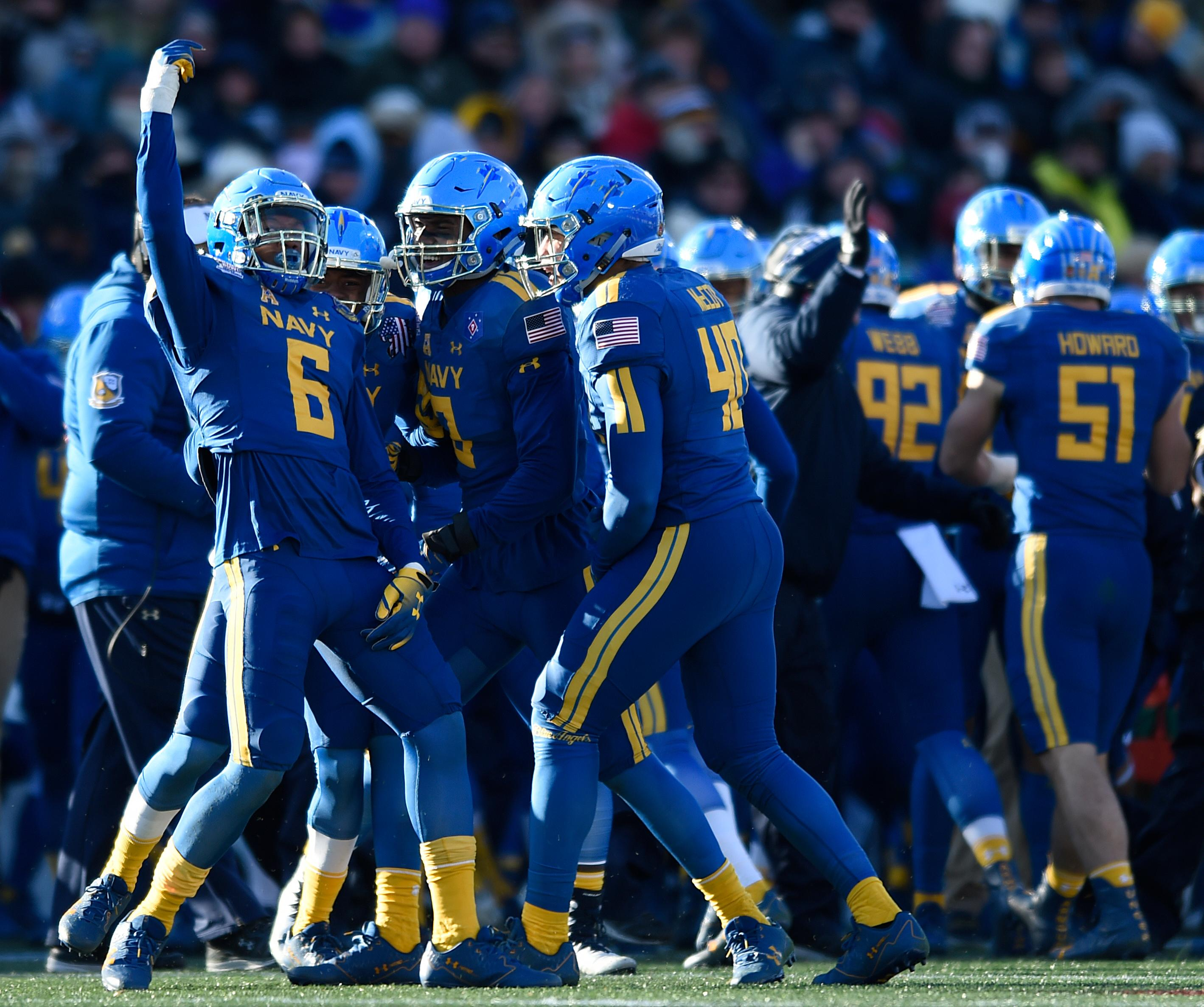 Navy's Sean Williams, left, celebrate his interception against Virginia in the first half of the Military Bowl NCAA college football game, Thursday, Dec. 28, 2017, in Annapolis, Md. (AP Photo/Gail Burton)