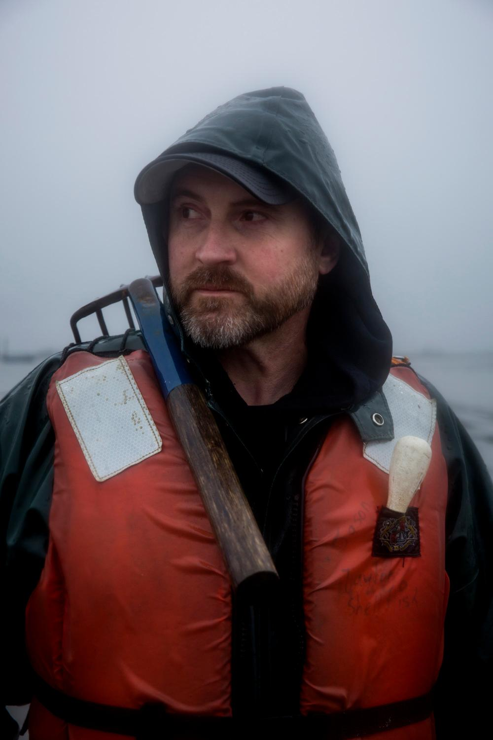Jason Ragan, director of clam and oyster farming at Taylor Shellfish, poses for a portait out on their farms in Samish Bay, Thursday, March 22, 2018, near Bellingham. (Sy Bean / Seattle Refined)