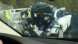 Vehicles mangled in highway crash