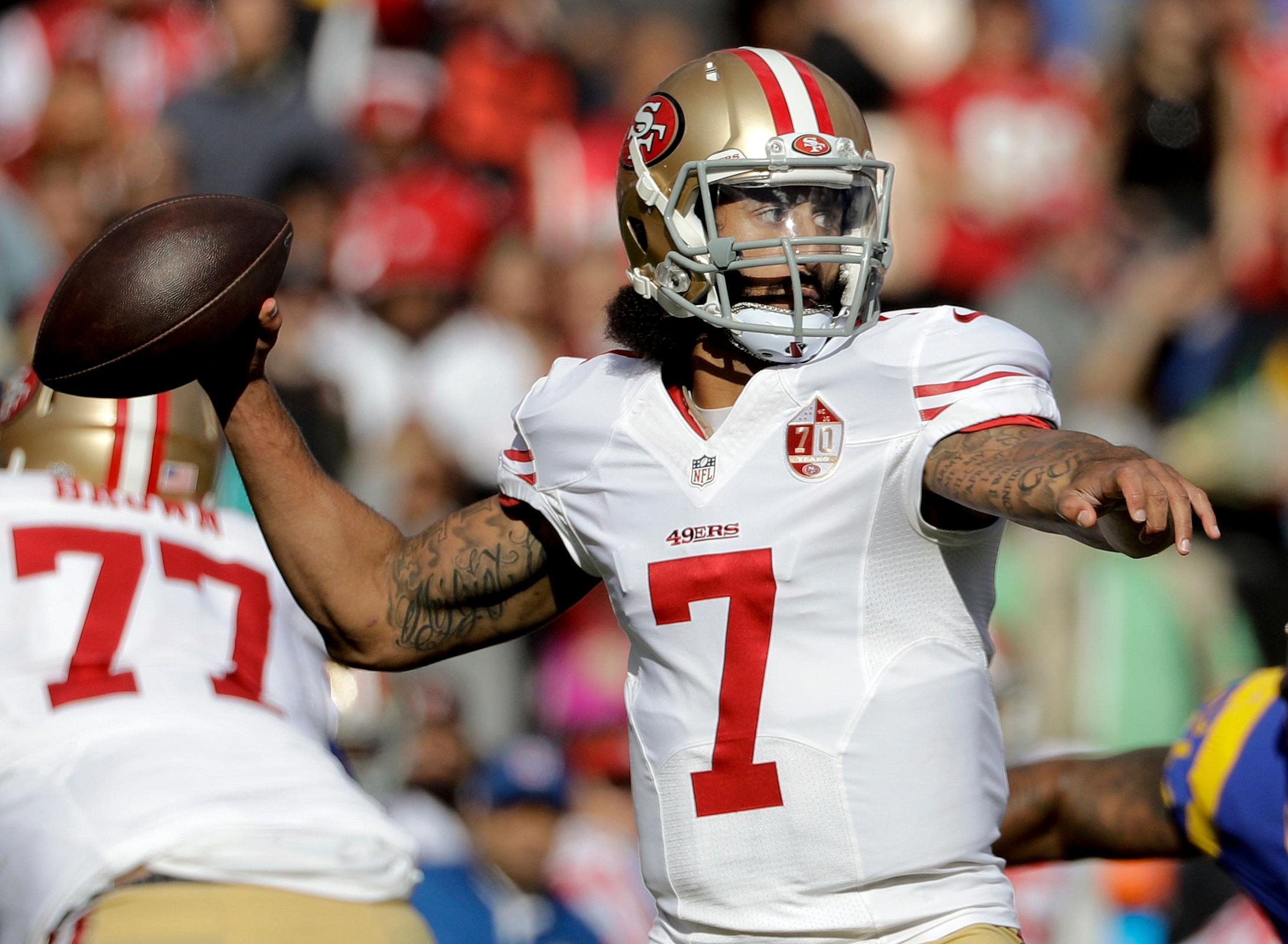 San Francisco 49ers quarterback Colin Kaepernick passes against the Los Angeles Rams during the first half of an NFL football game Saturday, Dec. 24, 2016, in Los Angeles. (AP Photo/Jae C. Hong)