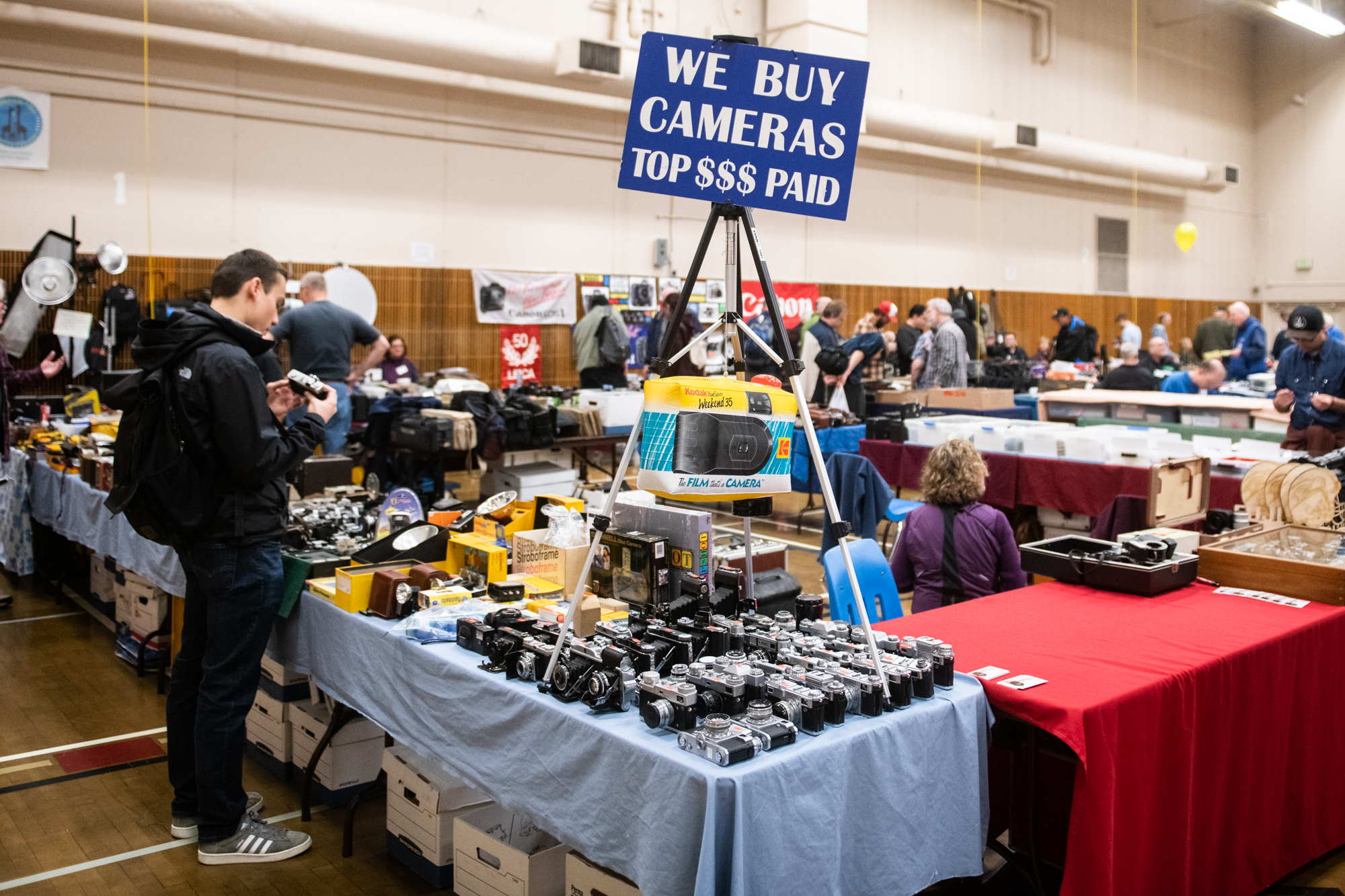 Regardless of your relationship to photography, the annual{&amp;nbsp;}<a  href=&quot;http://www.pspcs.org/our-annual-show&quot; target=&quot;_blank&quot; title=&quot;http://www.pspcs.org/our-annual-show&quot;>Puget Sound Photographic Collectors Society</a>'s camera show is truly a sight to behold. The largest camera swap in the western United States,{&amp;nbsp;}2019 marked the 39th annual show at Kent Commons. We dipped in for early entry to check out the stands before doors opened to the public at 10am. From Kodak paraphernalia to Fujifilm woefully past its expiration date (who doesn't love a good gamble?); there was lots to feast our eyes on. Click on to see cameras, doo-dads, and photographic accessories of all shapes, colors and sizes. (Image: Chona Kasinger / Seattle Refined)