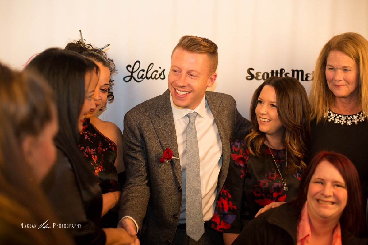 Macklemore greets Mary's Place, the non-profit beneficiary to the event,  staff at Runway to Freedom. (Image: Nakean Photography)