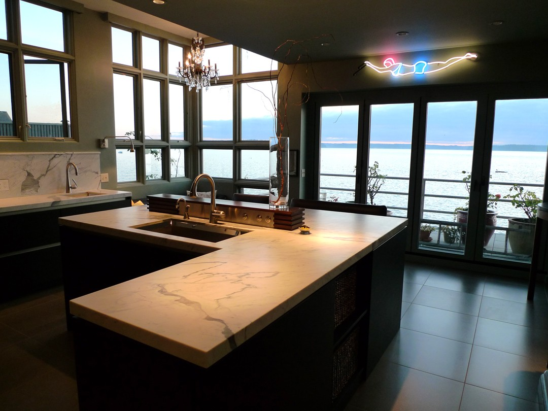 This Puget Sound House project was completed by Castanes Architects. The two-level house was remodeled to include a third level and provide space for this kitchen.   (Image: Puget Sound House / Porch.com)