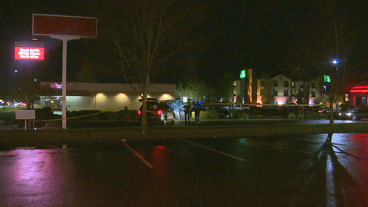 A man in his 20's was crushed when the vehicle he was working on fell on top of him in a Monroe parking lot Tuesday night, April 18, 2017. (Photo: KOMO News)