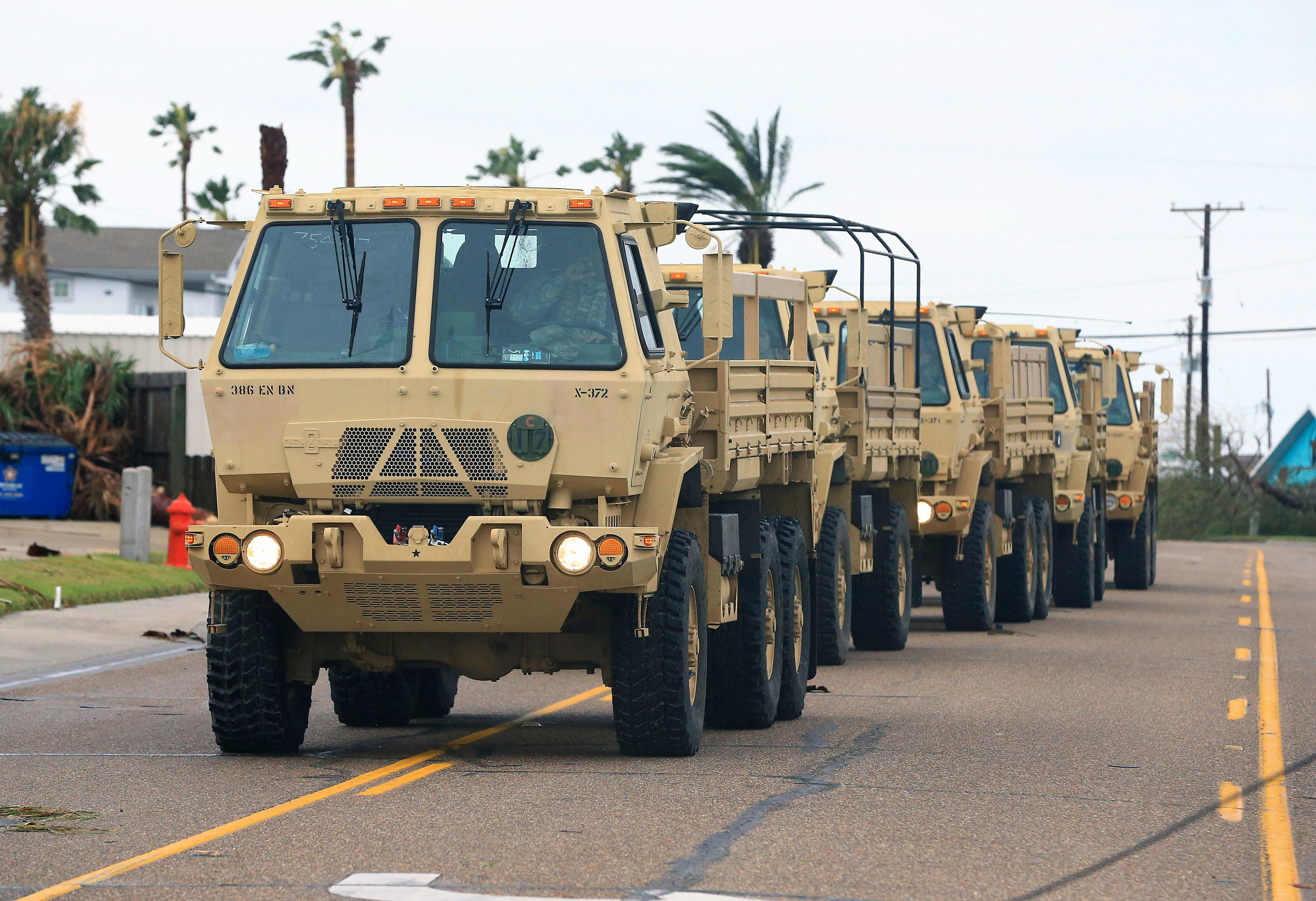 Members of the National Guard arrive at Port Aransas after Hurricane Harvey landed in the Coast Bend area on Saturday, Aug. 26, 2017, in Port Aransas, Texas. The National Hurricane Center has downgraded Harvey from a Category 1 hurricane to a tropical storm. Harvey came ashore Friday along the Texas Gulf Coast as a Category 4 storm with 130 mph winds, the most powerful hurricane to hit the U.S. in more than a decade. (Gabe Hernandez/Corpus Christi Caller-Times via AP)