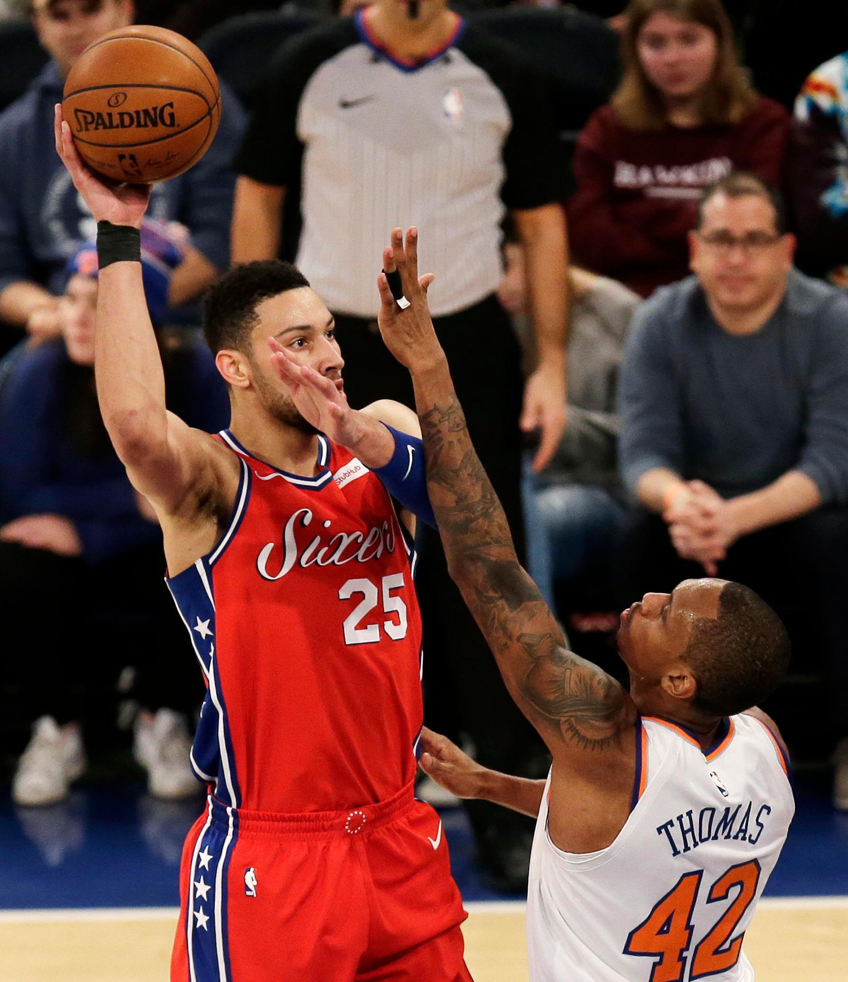 Philadelphia 76ers' Ben Simmons, left, shoots over New York Knicks' Lance Thomas during the first half of the NBA basketball game, Monday, Dec. 25, 2017, in New York. (AP Photo/Seth Wenig)
