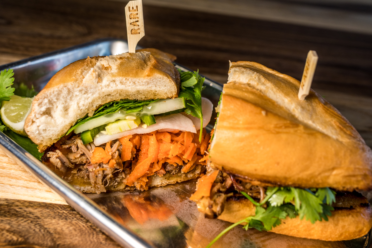 KY Bahn Mi: house-smoked pork, pickled carrots, cucumber, cilantro, jalapeño, and sriracha aioli / Image: Catherine Viox // Published: 8.2.20