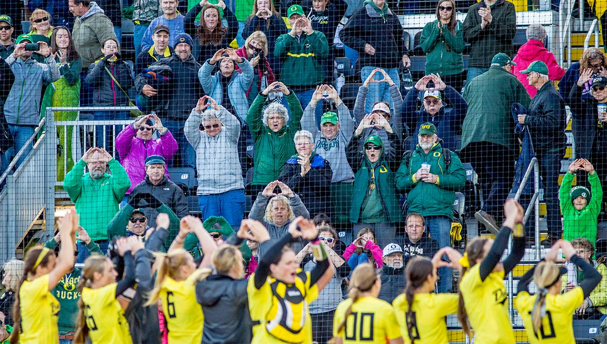 "The Duck's team throw up the ""O"" to the crowd. The Oregon Ducks defeated the Oregon State Beavers 8-0 in game one of the three-game Civil War series on Friday night at Jane Sanders Stadium. The game was 0-0 until Gwen Svekis (#21) hit a solo home run in the fourth inning. Mia Camuso hit a grand slam in the fifth inning, ending the game for the Ducks by mercy rule. With tonight's victory, the Ducks are 39-6 and 12-6 in Pac-12 play. Photo by August Frank, Oregon News Lab"