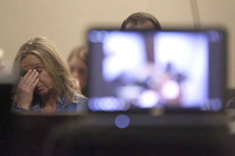 Tammy Weeks, mother of victim Nicole Lovell, reacts as David Eisenhauer's police interview video is played in Montgomery County Circuit Court in Christiansburg Va., Tuesday, Feb. 6, 2018. Eisenhauer is accused of killing 13-year-old Nicole Madison Lovell on Jan. 27, 2016. (Matt Gentry/The Roanoke Times via AP, Pool)