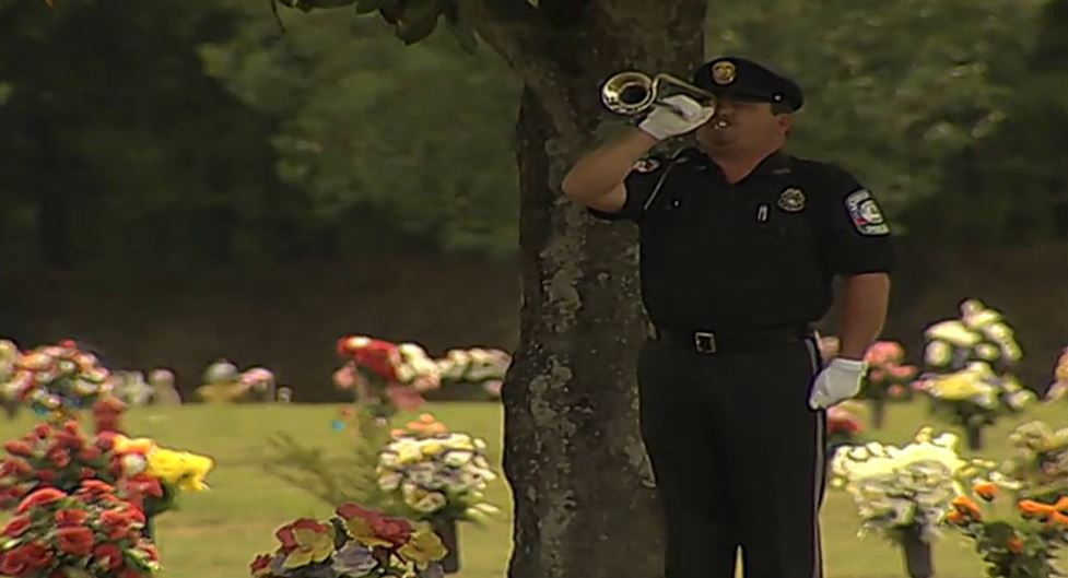 "An officer plays Taps at the funeral for Anthony ""TJ"" Freeman / WGXA"