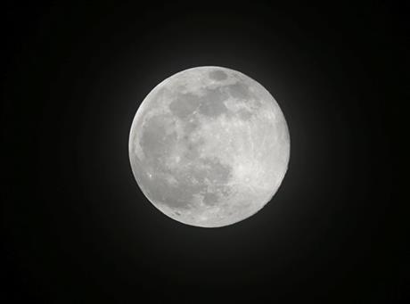 "The moon rises Saturday, July 12, 2014 over metropolitan Manila in the Philippines in one of the three ""Supermoon"" occurrences for this year. The phenomenon occurs when the moon is near the horizon and appears larger and brighter than other full moons."