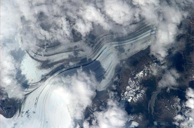 Glacier in Patagonia. almost looks like a highway. wonder what causes the streaks? (Photo & Caption: Mike Hopkins, NASA)