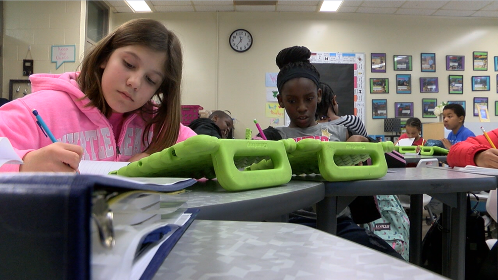 Technology In Elementary Classrooms : Elementary school students use new technology to enhance learning