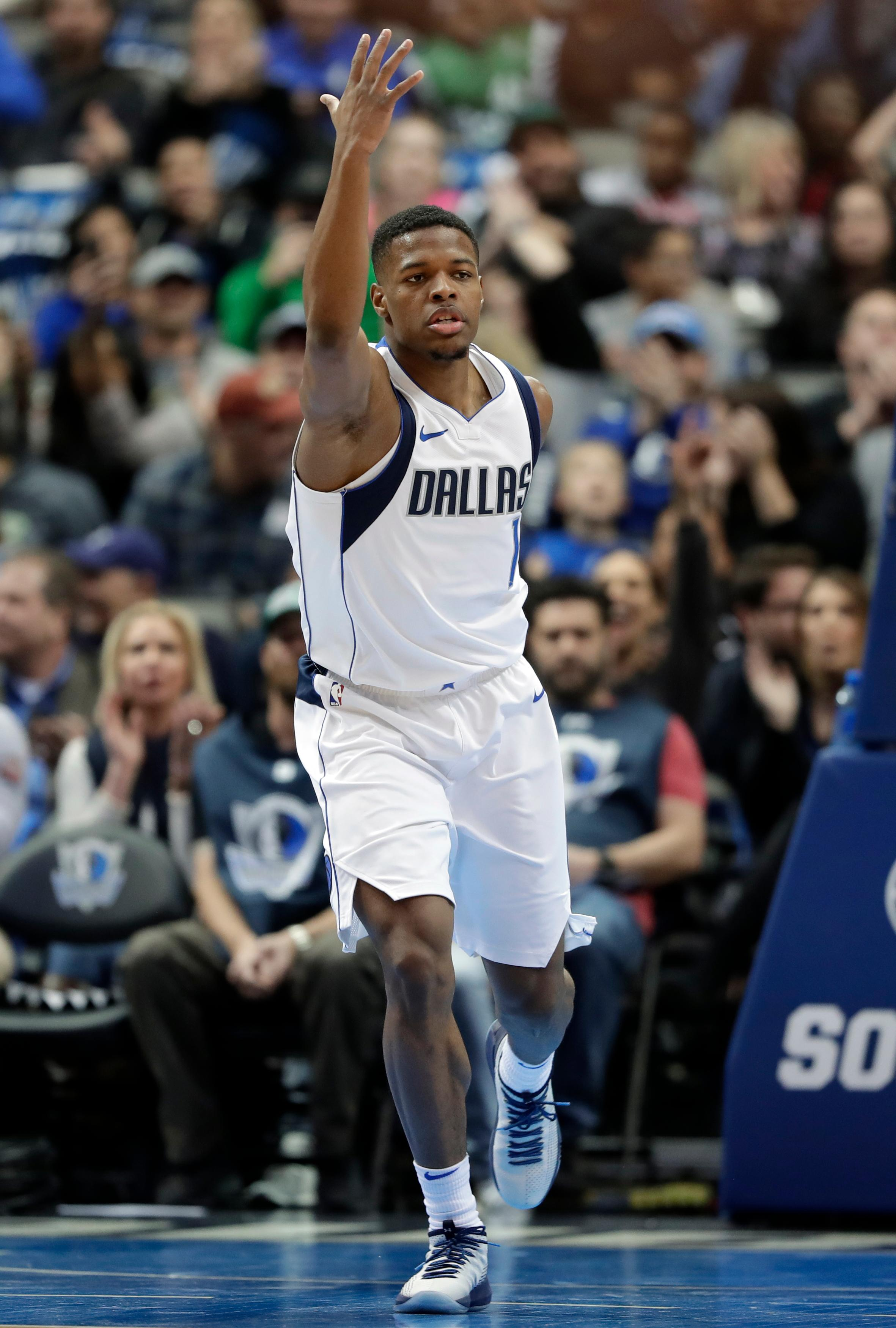 Dallas Mavericks' Dennis Smith Jr. celebrates after dunking on a breakaway play in the first half of an NBA basketball game against the Washington Wizards, Monday, Jan. 22, 2018, in Dallas. (AP Photo/Tony Gutierrez)