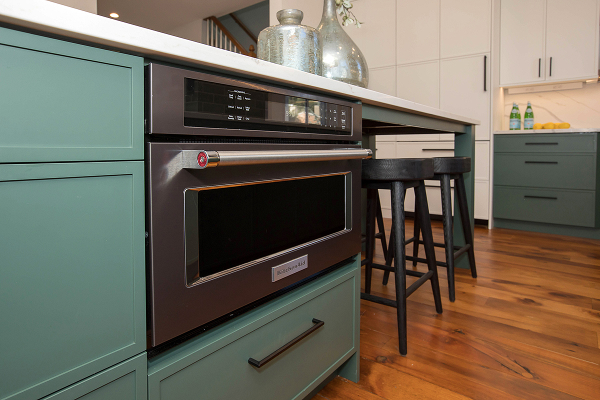 The green lower cabinetry was chosen because of its ability to feel both modern and traditional simultaneously. / Image courtesy of Neal's Design Remodel // Published: 11.1.20