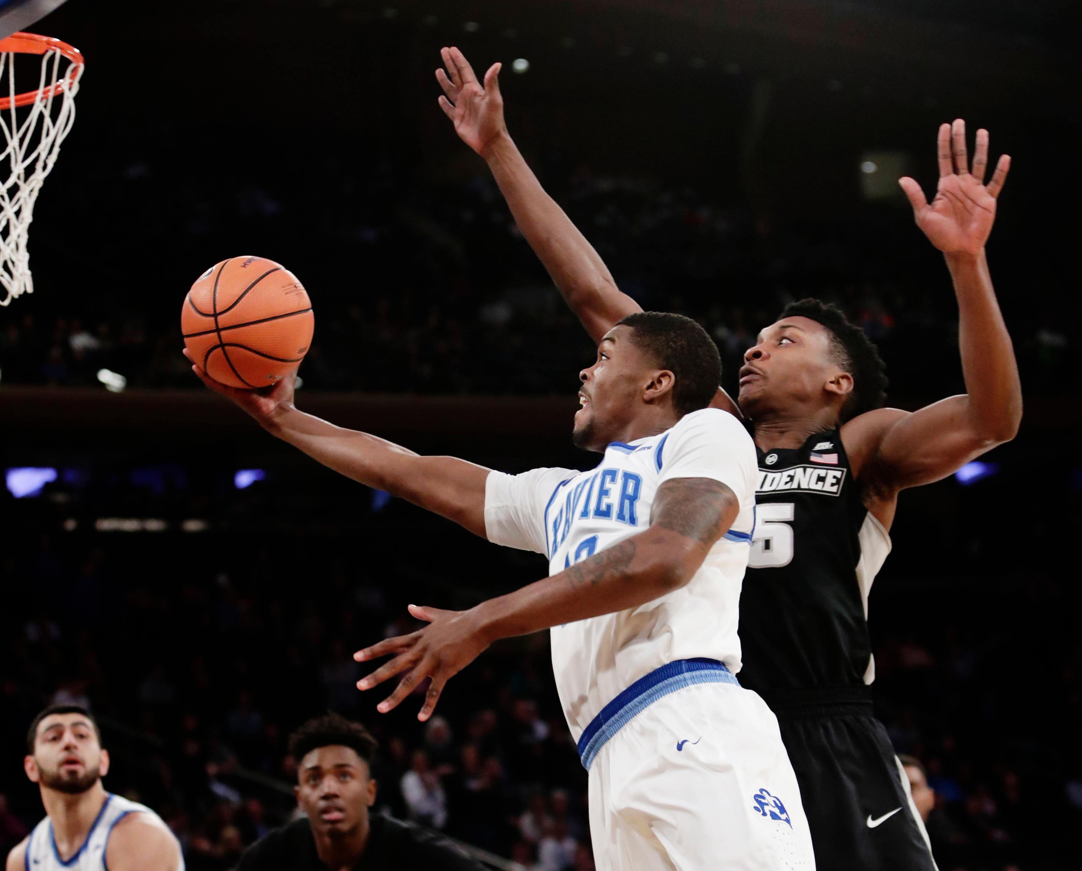 Xavier's Naji Marshall (13) drives past Providence's Rodney Bullock (5) during the first half of an NCAA college basketball game in the Big East men's tournament semifinals Friday, March 9, 2018, in New York. (AP Photo/Frank Franklin II)